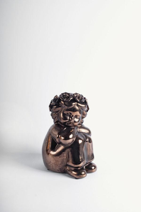 Statuetta bimbo seduto con tunica e coroncina